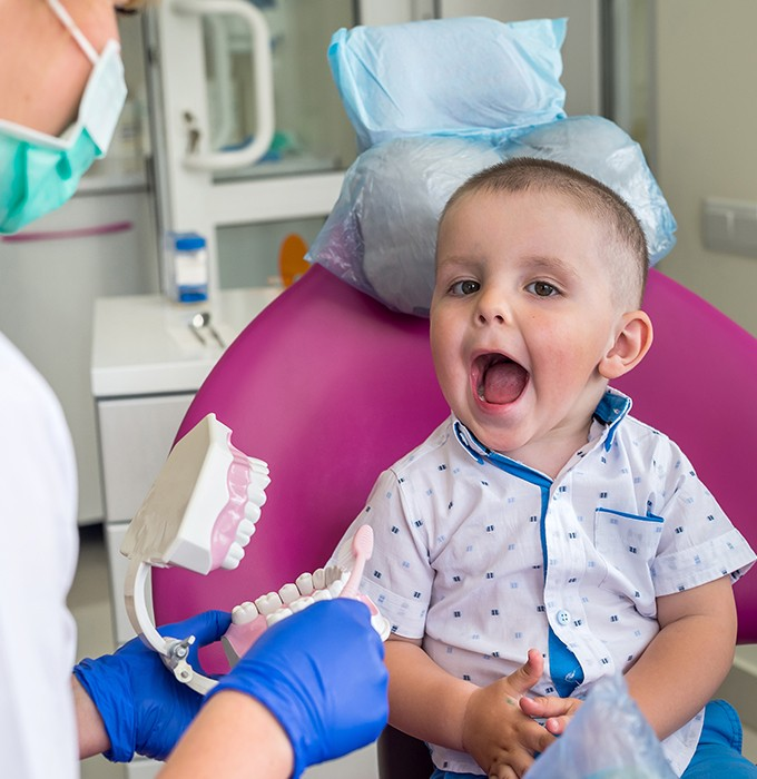 Little boy happy at first children's dentistry visit