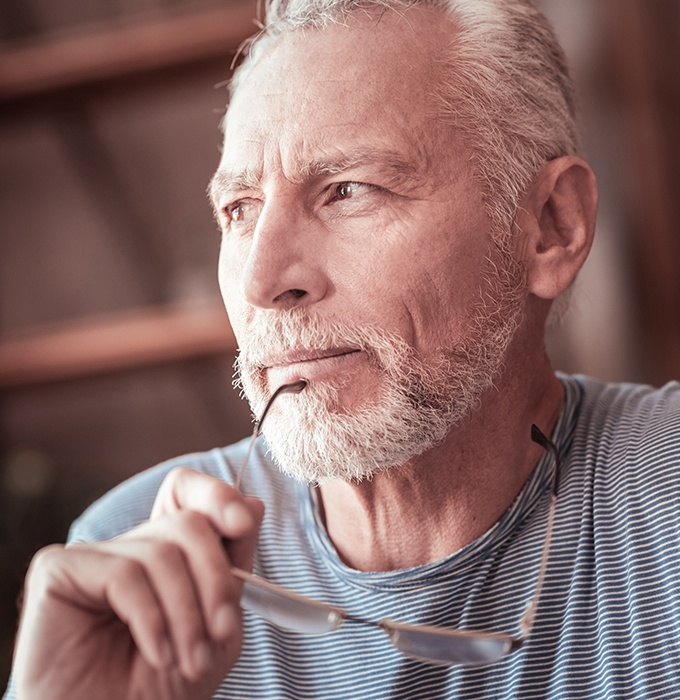 Older man considering dental implant tooth replacement