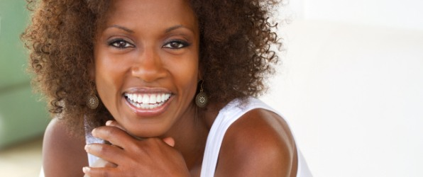Woman with healthy smile thanks to preventive dentistry