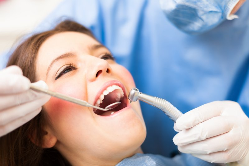 dentist inspecting patient during dental checkup
